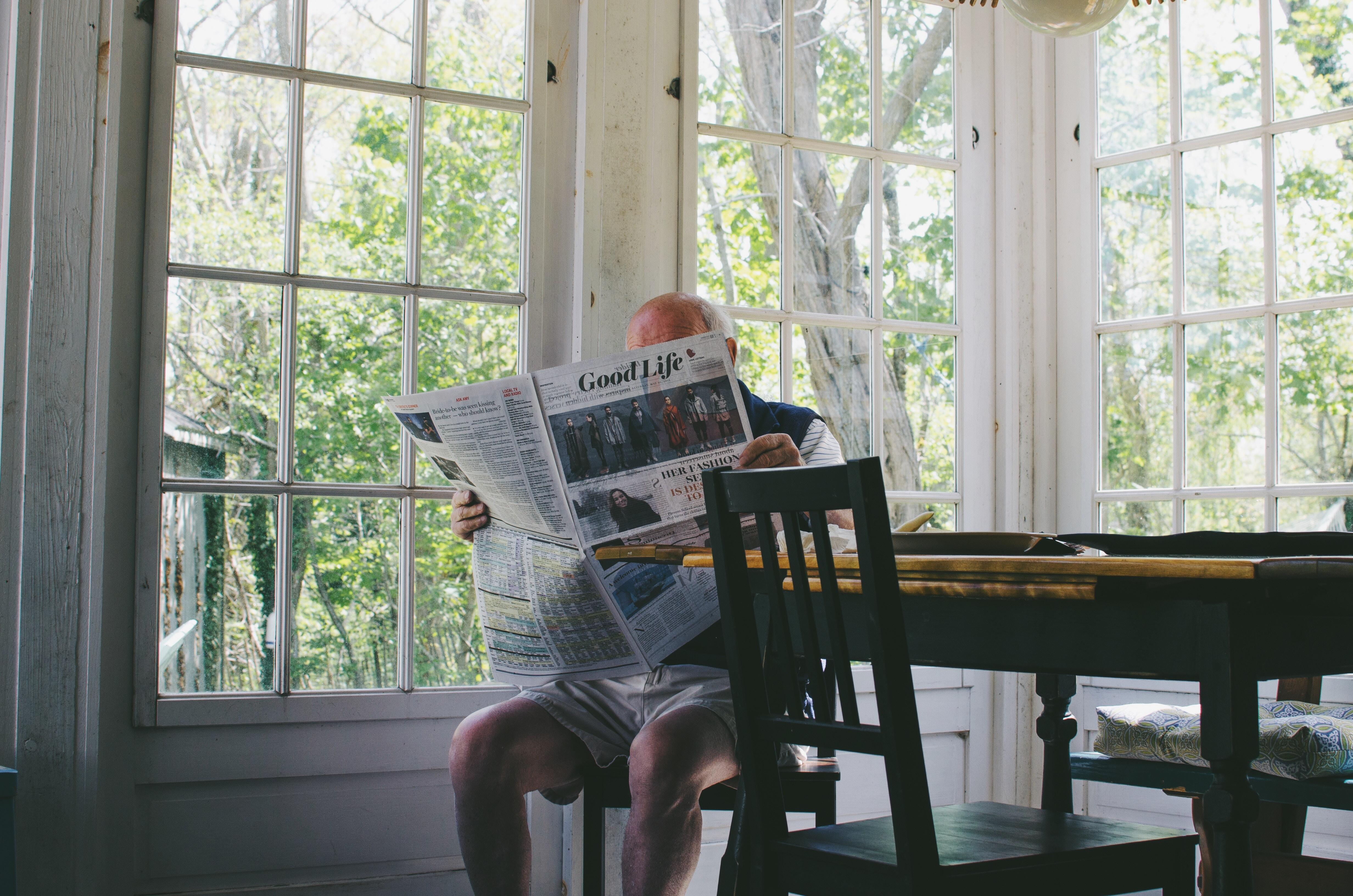 man reading newspaper  generation x